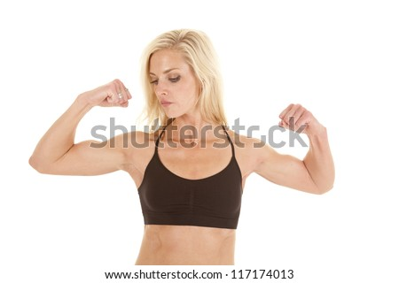 A woman flexing her biceps showing off her awesome arms.