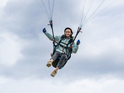 A woman flying a paraglider