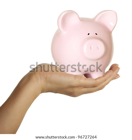 A woman hand holding a piggy bank. Isolated on white