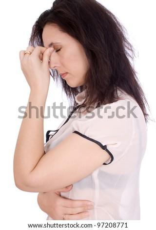 A woman having a headache, closeup isolated