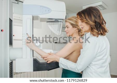 A woman having mammography examination at hospital.