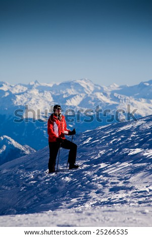 A woman hiking in the mountains. Winter scene.