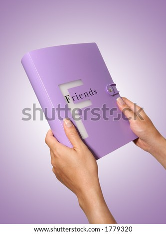 A woman holding a friends photo book