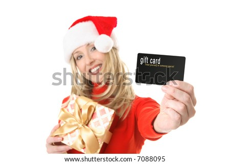 A woman holding a present and outstretched arm showing a gift card, credit card or other card or object.  Focus is the hand and card.  Change the card or text to suit your needs.