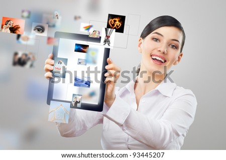 a woman holding a tablet pc