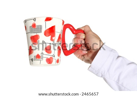 A woman holding a Valentines Day mug