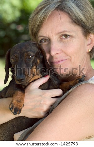 A woman holding her dog.