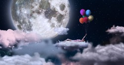 A woman holding on to colored balloons, flying in the sky lying on a cloud. On the sfin a giant moon. Concept of: dreams, freedom.