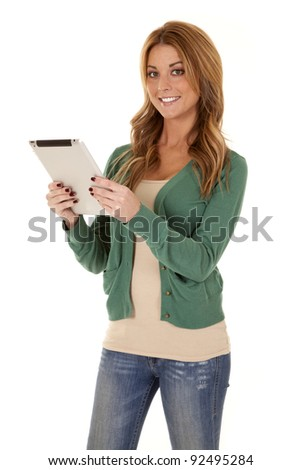 A woman holding on to her tablet with a smile on her face.
