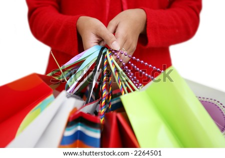A woman holding several colorful shopping bags