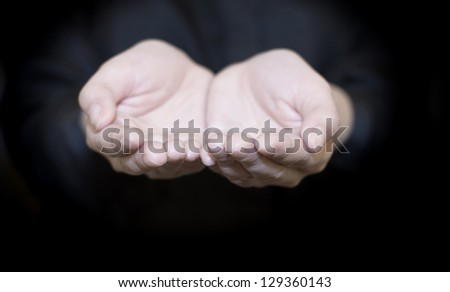 A woman holds a handful, hands