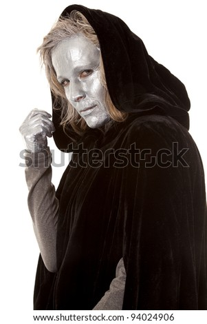 A woman in a black cape with her face and hands painted silver, with a mysterious feeling.