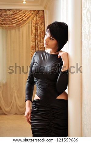 A woman in a black dress #121559686