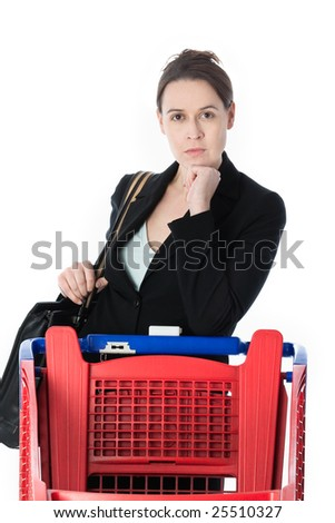 A woman in a business suit in a shopping scenario contemplating what to buy.