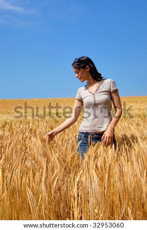A woman in a field of golden barley
