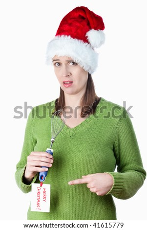 A woman in a funny Christmas scenario after receiving a not so good gift.