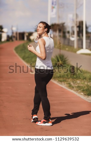 a woman in a jogging jog #1129639532