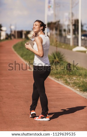 a woman in a jogging jog #1129639535