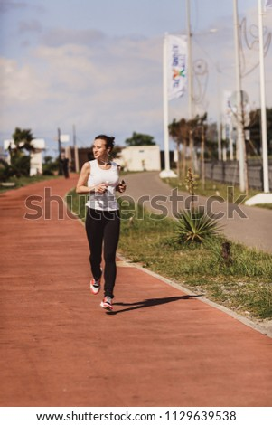 a woman in a jogging jog #1129639538