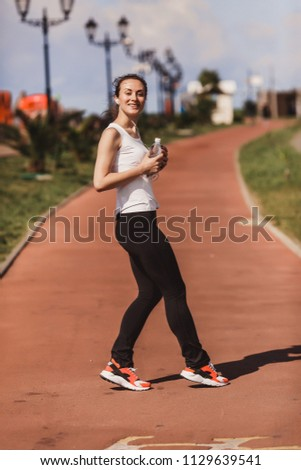 a woman in a jogging jog #1129639541
