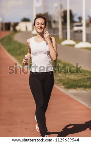 a woman in a jogging jog #1129639544
