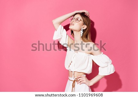 a woman in a light T-shirt and a skirt looks up                         #1101969608