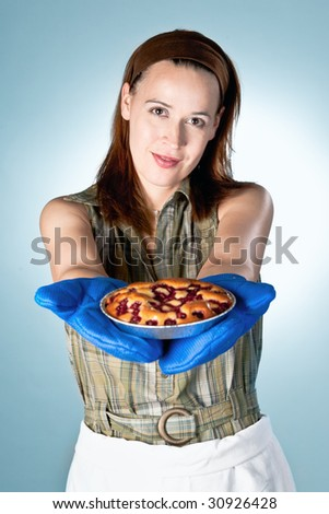A woman in a pie baking scenario presenting a finished pie