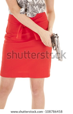 A woman in a red skirt holding a gun.