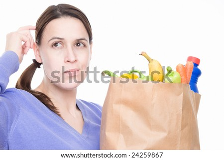 A woman in a shopping situation with a decision to make.