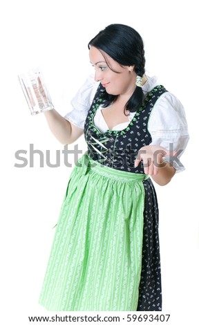 A woman in Bavarian dress with empty beer glasses