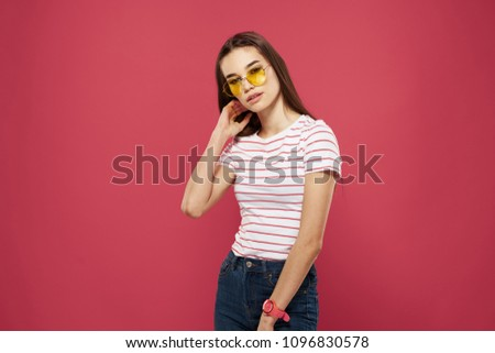 A woman in fashionable glasses and a T-shirt                              #1096830578