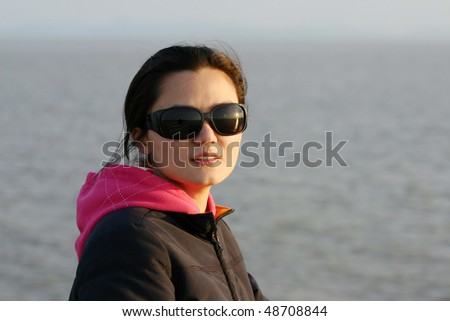 A woman in sunset with sun glasses