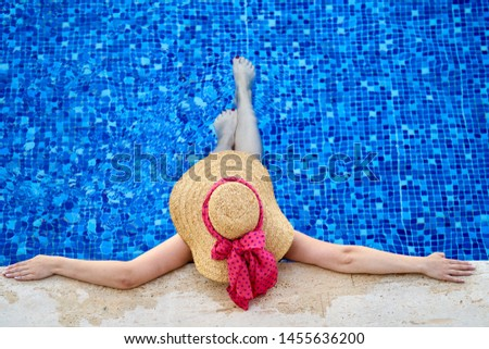 a woman in the relaxing pool #1455636200