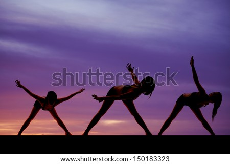 A woman in three dance positions silhouetted in the sunset.