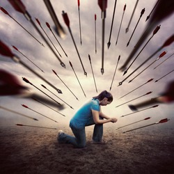 A woman is all alone and in prayer as she is surrounded by many arrows