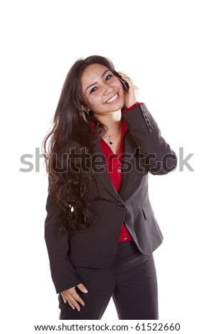 A woman is happy and talking on her cell phone