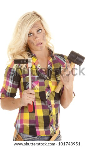 A woman is holding a socket and a rubber mallet.