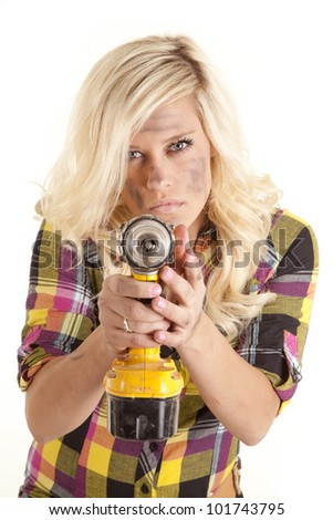 A woman is holding a yellow drill and pointing it with a mean expression on her face.