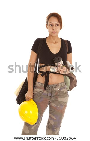 A woman is holding her construction hat and all her babies things.