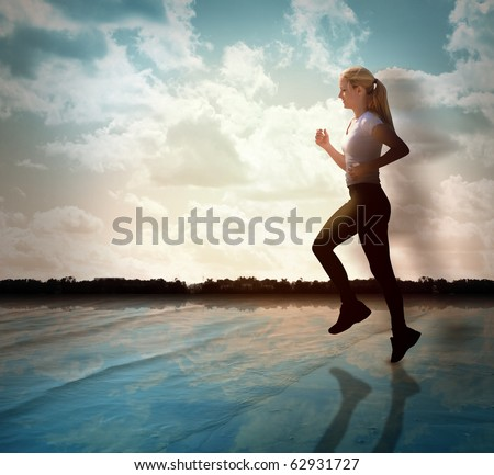 A woman is jogging for exercise on a beach with water and there are clouds in the sky. She has a silhouette fade. Use it for a health, sport or lifestyle theme.