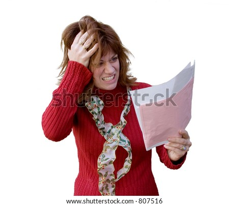 A woman is looking at her bills and feeling frazzled.