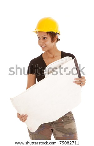 A woman is looking out of the image holding a set of plans.