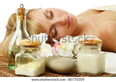 A woman is lying behind spa, cosmetic things