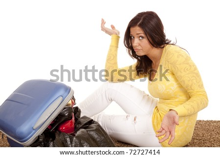 A woman is not sure how to make things fit in her suitcase
