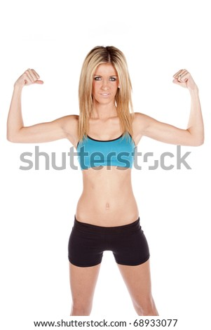 A woman is showing off her muscles.
