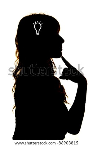 A woman is silhouetted and thinking with a light bulb in her head.