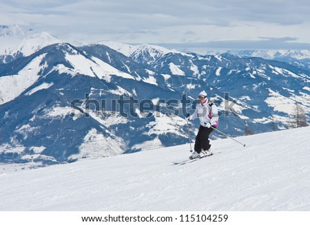 A woman is skiing at a ski resort. Ski resort Kaprun - Maiskogel. Austria