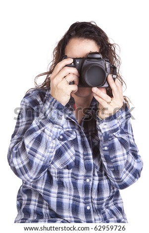 A woman is taking a picture with her camera
