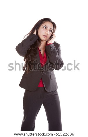 A woman is talking on her cell phone and looks worried.