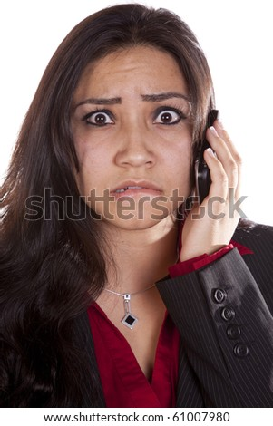A woman is talking on her cell phone with a very frustrated expression on her face.